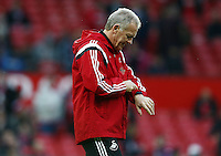 Swansea City caretaker manager Alan Curtis looks at his watch during the Barclays Premier League match between Manchester United and Swansea City played at Old Trafford, Manchester on January 2nd 2016