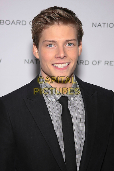 HUNTER PARRISH .National Board of Review of Motion Picture Awards Gala held at Cipriani 42nd Street, New York, NY, USA,.12th January 2010..portrait headshot  black tie suit grey gray checked check shirt smiling .CAP/LNC/TOM.©LNC/Capital Pictures.