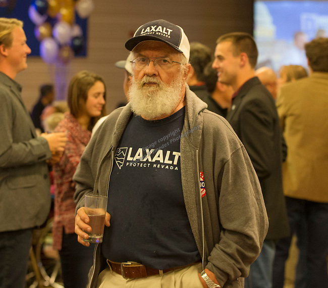 Adam Laxalt supporters watch election results at the Grand Sierra Resort in Reno, Nev., Tuesday, Nov. 6, 2018. (AP Photo/Tom R. Smedes)<br /> )