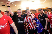 Lincoln City kit manager Terry Bourne, left, and Lincoln City's Harry Toffolo celebrate after winning the league<br /> <br /> Photographer Chris Vaughan/CameraSport<br /> <br /> The EFL Sky Bet League Two - Lincoln City v Tranmere Rovers - Monday 22nd April 2019 - Sincil Bank - Lincoln<br /> <br /> World Copyright © 2019 CameraSport. All rights reserved. 43 Linden Ave. Countesthorpe. Leicester. England. LE8 5PG - Tel: +44 (0) 116 277 4147 - admin@camerasport.com - www.camerasport.com