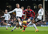 17th March 2018, Craven Cottage, London, England; EFL Championship football, Fulham versus Queens Park Rangers; Pawel Wszolek of Queens Park Rangers shot is blocked by Tim Ream and Denis Odoi of Fulham