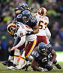 Washington Redskins quarterback Rex Grossman is sacked by Seattle Seahawks linebacker Malcolm Smith in the third quarter at  CenturyLink Field in Seattle, Washington on November 27, 2011.   Redskins stunned the Seattle Seahawks 23-17. ©2011 Jim Bryant Photo. All Rights Reserved.