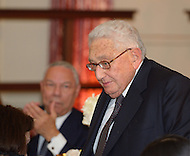 October 27, 2011  (Washington, DC)  Colin Powell (left) applauds former Secretary of State Henry A. Kissinger as he walks to the podium at the 50th Anniversary Celebration of the Diplomatic Rooms at the State Department in Washington.    (Photo by Don Baxter/Media Images International)