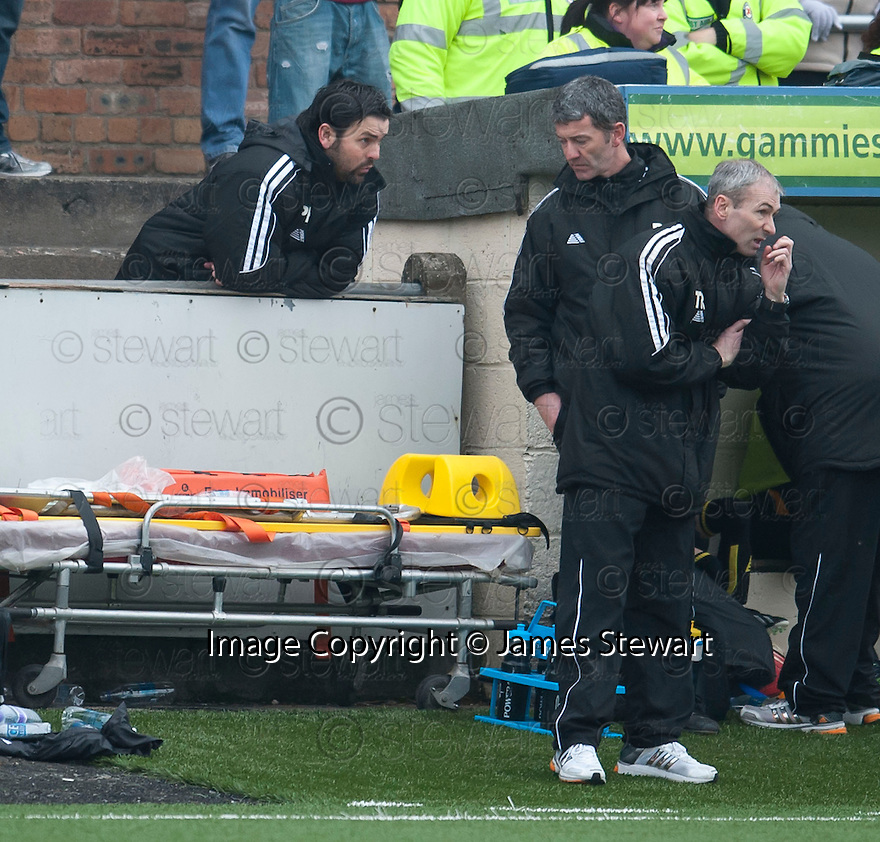Alloa Manager Paul Hartley gets instructions Assistant Manager Paddy Connelly from his position in the enclosure behind the dug out.