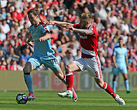 Burnley's Ashley Barnes gets away from Middlesbrough's Adam Clayton<br /> <br /> Photographer David Shipman/CameraSport<br /> <br /> The Premier League - Middlesbrough v Burnley - Saturday 8th April 2017 - Riverside Stadium - Middlesbrough<br /> <br /> World Copyright &copy; 2017 CameraSport. All rights reserved. 43 Linden Ave. Countesthorpe. Leicester. England. LE8 5PG - Tel: +44 (0) 116 277 4147 - admin@camerasport.com - www.camerasport.com