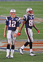 Feb 3, 2008; Glendale, AZ, USA; New England Patriots quarterback (12) Tom Brady and wide receiver (81) Randy Moss against the New York Giants during Super Bowl XLII at the University of Phoenix Stadium.  Mandatory Credit: Mark J. Rebilas-