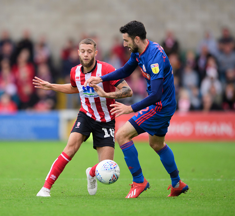 Lincoln City's Jorge Grant vies for possession with Sunderland's Conor McLaughlin<br /> <br /> Photographer Chris Vaughan/CameraSport<br /> <br /> The EFL Sky Bet League One - Lincoln City v Sunderland - Saturday 5th October 2019 - Sincil Bank - Lincoln<br /> <br /> World Copyright © 2019 CameraSport. All rights reserved. 43 Linden Ave. Countesthorpe. Leicester. England. LE8 5PG - Tel: +44 (0) 116 277 4147 - admin@camerasport.com - www.camerasport.com