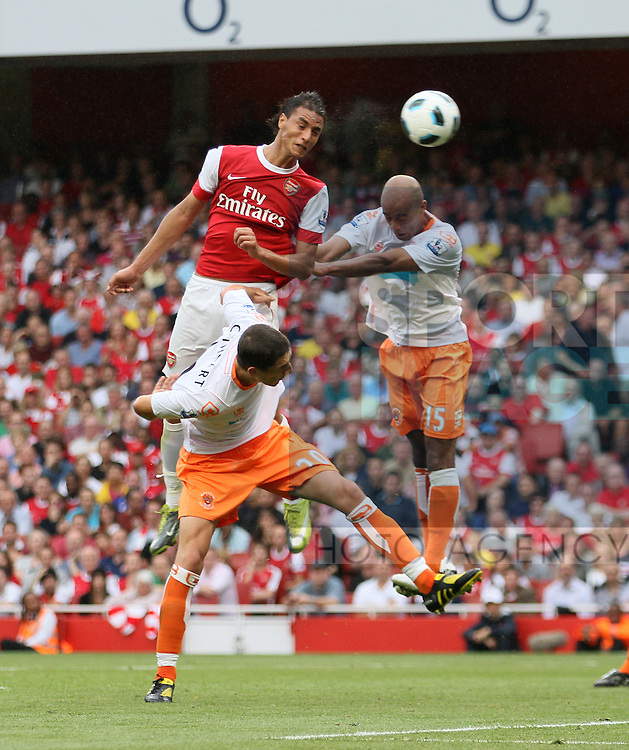 Arsenal's Marouane Chamakh scoring his sides sixth goal