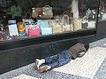 sleeping on the streets in Porto in front of a shop window