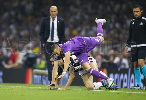 June 3rd 2017, National Stadium of Wales , Wales; UEFA Champions League Final, Juventus FC versus Real Madrid; Leonardo Bonucci of Juventus upends Karim Benzema of Real Madrid