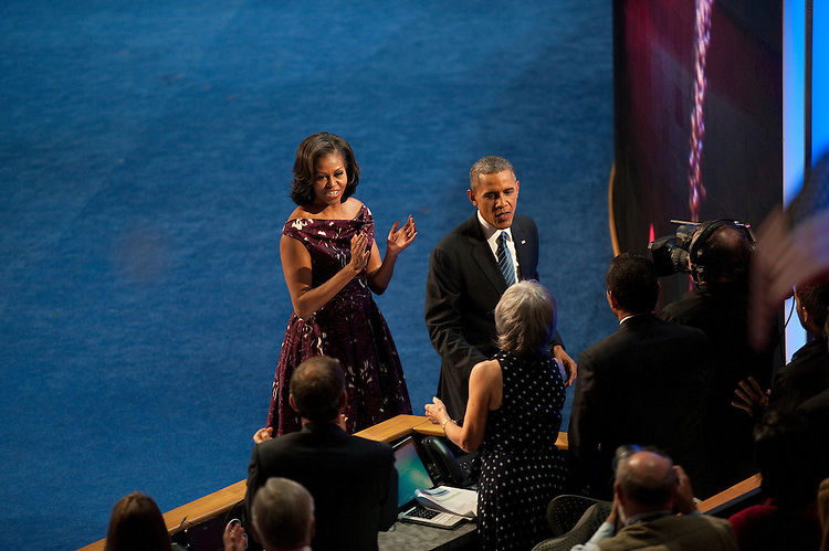 UNITED STATES - September 6: President Barack Obama and First Lady Michelle Obama thank staff after accepting the nomination during the final day of the Democratic National Convention at Time Warner Cable Arena on September 6, 2012 in Charlotte, North Carolina. (Photo By Douglas Graham/CQ Roll Call)