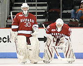 Raphael Girard (Harvard - 30), Ryan Carroll (Harvard - 35) - The Boston University Terriers defeated the visiting Harvard University Crimson 5-2 on Saturday, January 15, 2011, at Agganis Arena in Boston, Massachusetts.