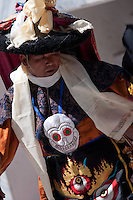 Portait of a monk from the Chemrey monastery dancing the Chamms masked dance in Ladakh