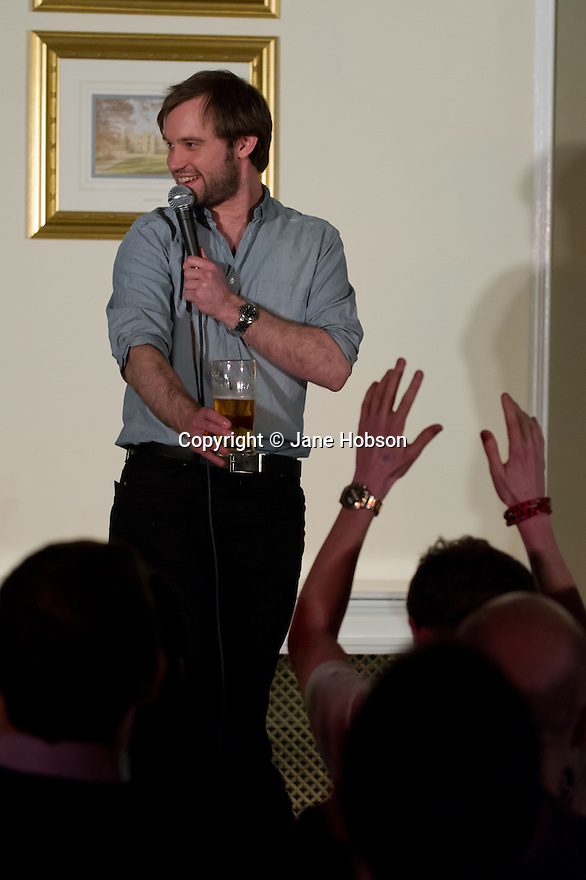 Harrogate, UK. 20.3.12. Sitting Room Comedy at the St George Hotel hosts the legendary Arthur Smith with support from Naz Osmanoglu. Picture shows Naz Osmanoglu. Photo credit: Jane Hobson.