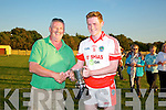 Derek Daly presents the the Monsignor Collins Cup to  St. Pats, Blennerville's Captain Liam O'Sullivan,  winners of    St Brendan's  Board League Final against John Mitchels at the Na Gaeil GAA ground on Saturday.