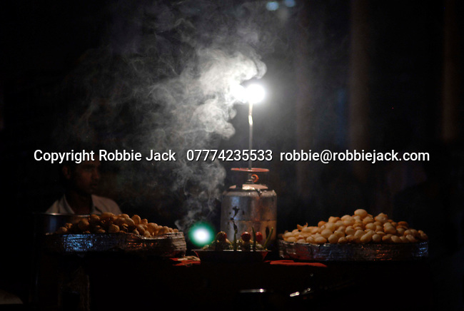 Street vendor working under calor gas light in the Paharganj district of New Delhi, India.