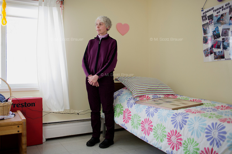Diane Booher is the younger sister of Randy and Ronnie Russo, 60, seen here in their bedroom at the residences in Malone Park at the Fernald Developmental Center in Waltham, Massachusetts, USA.  The twins, both blind and unable to speak, have lived at the Fernald Center for 55 years.