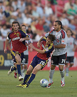 Real Salt Lake midfielder Ned Grabavoy (20) attempts to control ball as Toronto FC midfielder Dwayne De Rosario (14) defends. Salt Lake Real defeated Toronto FC, 3-0, at Rio Tinto Stadium on June 27, 2009.