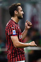 Hakan Calhanoglu of AC Milan celebrates after scoring the goal of 1-0 during the Serie A football match between AC Milan and Atalanta BC at stadio Giuseppe Meazza in Milano ( Italy ), July 24th, 2020. Play resumes behind closed doors following the outbreak of the coronavirus disease. <br /> Photo Image Sport / Insidefoto