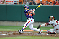 Clemson Tigers left fielder Jay Baum #13 swings at a pitch during a game against the Florida State Seminoles at Doug Kingsmore Stadium on March 22, 2014 in Clemson, South Carolina. The Seminoles defeated the Tigers 4-3. (Tony Farlow/Four Seam Images)