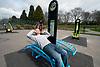 Man using outdoor allweather gym equipment Havering London UK