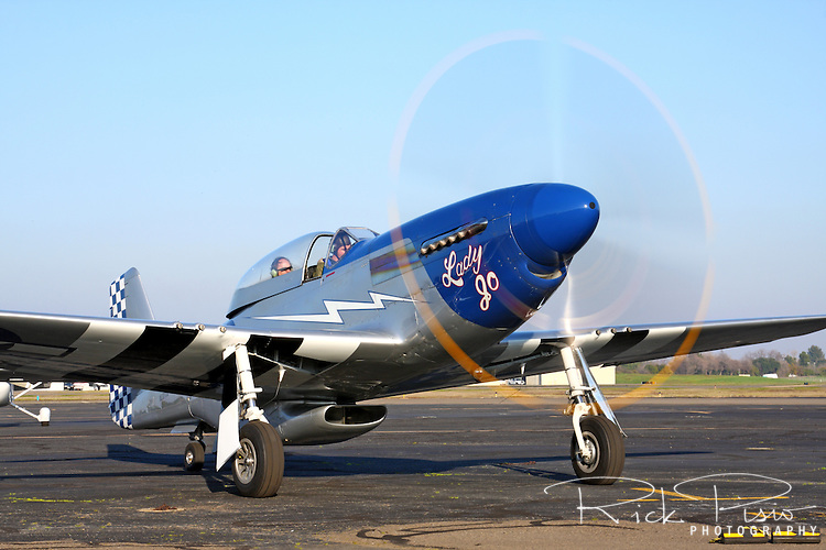 TF-51D Mustang 'Lady Jo' is taxied out for a flight at Sacramento Executive Airport during a Mustang gathering hosted by Dream Machines on January 30th, 2009. Lady Jo is a regular participant at the Reno National Championship Air Races each September in Nevada.