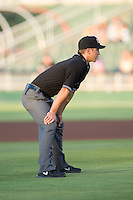 South Atlantic League umpire Derek Gonzales handles the calls on the bases during the game between the Hagerstown Suns and the Kannapolis Intimidators at CMC-Northeast Stadium on May 31, 2014 in Kannapolis, North Carolina.  The Intimidators defeated the Suns 4-3 in game two of a double-header.  (Brian Westerholt/Four Seam Images)