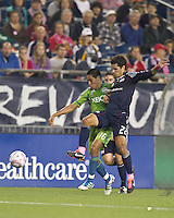 Seattle Sounders forward David Estrada (16) and New England Revolution midfielder Benny Feilhaber (22) battle for the ball. In a Major League Soccer (MLS) match, the Seattle Sounders FC defeated the New England Revolution, 2-1, at Gillette Stadium on October 1, 2011.
