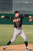 Ryan McMahon (5) of the Modesto Nuts makes a throw during a game against the Lancaster JetHawks at The Hanger on April 25, 2015 in Lancaster, California. Lancaster defeated Modesto, 5-4. (Larry Goren/Four Seam Images)