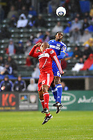 Pablo Escobar , Collins John (red)...Kansas City Wizards played to a 2-2 tie with Chicago Fire at Community America Ballpark, Kansas City, Kansas.