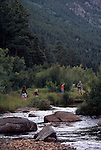 Family of five hiking near Big Thompson River, Rocky Mtn Nat'l Park, CO
