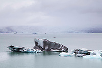 Glacial Icebergs in Jokulsarlon Lagoon with Glacier in Background