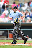 Home plate umpire Matt McCoy gets in position during a game between the Mississippi Braves and Montgomery Biscuits on April 22, 2014 at Riverwalk Stadium in Montgomery, Alabama.  Mississippi defeated Montgomery 6-2.  (Mike Janes/Four Seam Images)