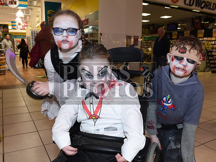 Ashley and Lorcan McGahey and Tadhg Murphy at the Halloween celebrations at the Drogheda Town Centre. Photo:Colin Bell/pressphotos.ie