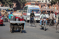 Jaipur, Rajasthan, India.  Mid-day Street Traffic in Central Jaipur.  Buses, Push-carts, Motorbikes, Bicycles, Cars, and Pedestrians all Share the Road.