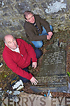 HEADSTONES: Locals Dan Cronin and Oliver Savage with one of the headstones in Killaha Abbey in Milltown which were knocked by vandals recently.