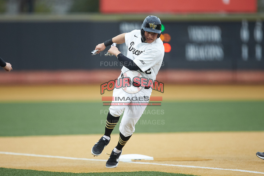 Michael Ludowig (22) of the Wake Forest Demon Deacons rounds third base during the game against the Sacred Heart Pioneers at David F. Couch Ballpark on February 15, 2019 in  Winston-Salem, North Carolina.  The Demon Deacons defeated the Pioneers 14-1. (Brian Westerholt/Four Seam Images)