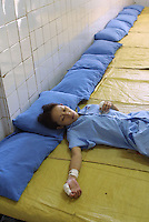 Ah Li, a 21 year-old female drug addict sleeps in a drug rehabilitation centre in Bao'an, China.  Ah Li moved to Shenzhen from northern China when just sixteen years old after the break-up of her family. She was tricked into prostitution and initially forced to take drugs until she became addicted and dependent on her gang bosses.