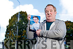 Patrick Coffey with a photo of his son Danny who has been missing for 6 weeks