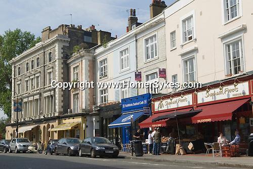 Primrose Hill. Regents Park Road, shops and cafe. London UK 2008