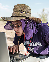 Shray Singh with the University of Washington reading data from his team's rocket after launch at the Spaceport America Cup near the town of Truth or Consequences, New Mexico, Friday, June 23, 2017. The International Intercollegiate Rocket Engineering Competition hosted over 110 teams from colleges and universities in eleven countries. Students launched solid, liquid, and hybrid rockets to target altitudes of 10,000 and 30,000 feet. The 2017 Spaceport America Cup winner was the University of Michigan, Ann Arbor, Team 79.<br /> <br /> Photo by Matt Nager