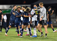 LAKE BUENA VISTA, FL - JULY 26: Graham Zusi of Sporting KC tries to console Leonard Owusu of Vancouver Whitecaps FC during a game between Vancouver Whitecaps and Sporting Kansas City at ESPN Wide World of Sports on July 26, 2020 in Lake Buena Vista, Florida.