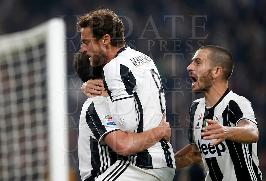 Calcio, Serie A: Juventus Stadium. Torino, Juventus Stadium, 29 ottobre 2016.<br /> Juventus' Gonzalo Higuain, left, celebrates with teammates Claudio Marchisio, center, and Leonardo Bonucci, after scoring the winning goal during the Italian Serie A football match between Juventus and Napoli at Turin's Juventus Stadium, 29 October 2016. Juventus won 2-1.<br /> UPDATE IMAGES PRESS/Isabella Bonotto