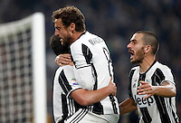 Calcio, Serie A: Juventus Stadium. Torino, Juventus Stadium, 29 ottobre 2016.<br /> Juventus&rsquo; Gonzalo Higuain, left, celebrates with teammates Claudio Marchisio, center, and Leonardo Bonucci, after scoring the winning goal during the Italian Serie A football match between Juventus and Napoli at Turin's Juventus Stadium, 29 October 2016. Juventus won 2-1.<br /> UPDATE IMAGES PRESS/Isabella Bonotto