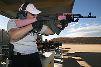 USA. Arizona state. Phoenix. Ben Avery Shooting Facility. The Ben Avery Shooting Facility, formerly the Black Canyon Shooting Range, is one of the largest publicly operated shooting facilities in the United States. Melodie Anne Coffman is shooting with her AK 47 and trains her skills with a semi-automatic rifle. She is a NRA ( National Rifle Association) certified instructor in Basic Pistol and defense courses. The AK-47 (also known as the Kalashnikov, AK, or Kalash) is a selective-fire automatic or semi-automatic gas-operated 7.62×39mm assault rifle, developed in the Soviet Union by Mikhail Kalashnikov. A firearm is a portable gun, being a barreled weapon that launches one or more projectiles often driven by the action of an explosive force. Most modern firearms have rifled barrels to impart spin to the projectile for improved flight stability. The word firearms usually is used in a sense restricted to small arms (weapons that can be carried by a single person). The right to keep and bear arms is a fundamental right protected in the United States by the Second Amendment of the Bill of Rights in the Constitution of the United States of America and in the state constitutions of Arizona and 43 other states. 31.01.16 © 2016 Didier Ruef