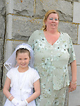 Tara Sheridan who received her first holy communion in Duleek church pictured with mam Michelle. Photo:Colin Bell/pressphotos.ie