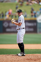 Birmingham Barons relief pitcher Ryan Burr (32) gets ready to deliver a pitch during a game against the Pensacola Blue Wahoos on May 9, 2018 at Regions FIeld in Birmingham, Alabama.  Birmingham defeated Pensacola 16-3.  (Mike Janes/Four Seam Images)