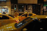 Yellow woman among yellow taxi.