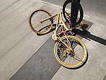 Painted with gold bicycle chained to a post