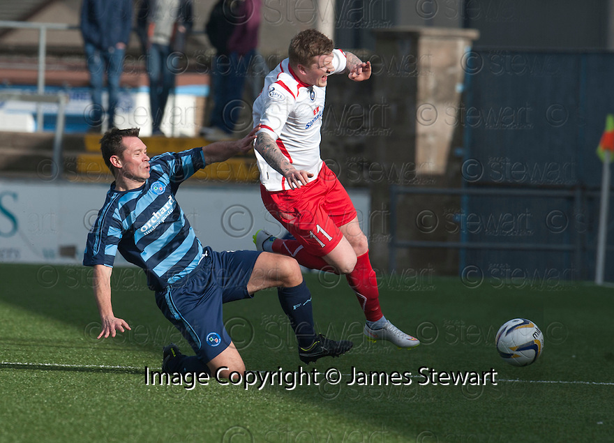 Stranraer's Willie Gibson is caught late by Forfar's Derek Young.